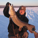 Ice Fisherman holding a large fish