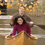 Man & woman canoeing in the fall