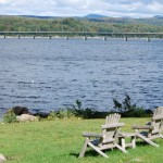 Adirondack chairs overlooking the water