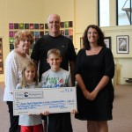 TRIATHLON DONATES TO LOCAL CHARITY