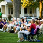 People sitting at an outdoor event