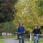 Two people biking