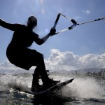 A wakeboarder out on the water